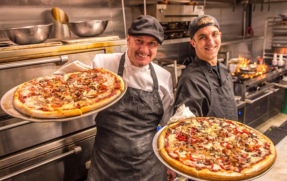chefs presenting pizza